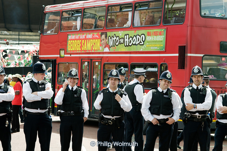 Police regulate traffic on Children's Day at Notting Hill Carnival