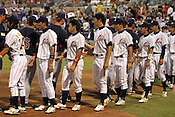 Japanese players shake hands with Team USA players after losing 4-3 in Game 3 of the annual Collegiate Friendship Series between Team USA and Japan on Tuesday, July 5, 2011. Photo by Al Drago.