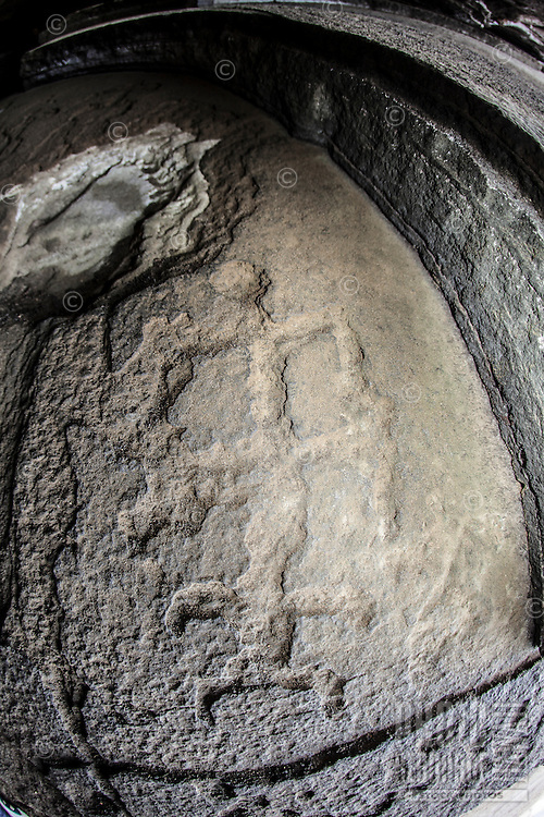 Ancient Hawaiian petroglyphs of human figures in a Ka'iwi Shoreline cave shelter,  Honolulu, O'ahu