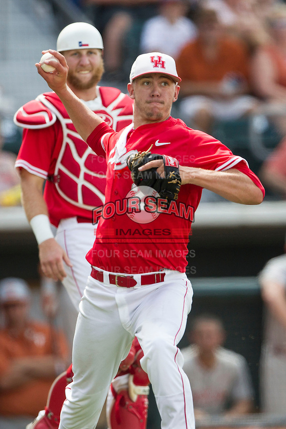 Houston Cougars pitcher Jake Lemoine (26) makes a throw to first base after fielding a sacrifice bunt during the NCAA baseball game against the Texas Longhorns on June 6, 2014 at UFCU Disch–Falk Field in Austin, Texas. The Longhorns defeated the Cougars 4-2 in Game 1 of the NCAA Super Regional. (Andrew Woolley/Four Seam Images)