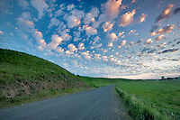 Backroad with puffy clouds in Wallowa County, Oregon