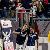 Foxborough, Massachusetts - September 1, 2018: In a Major League Soccer (MLS) match, New England Revolution (blue/white) tied Portland Timbers (white/green), 1-1, at Gillette Stadium.<br /> Scott Caldwell celebrates his goal with teammate.