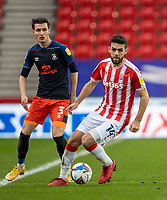 20th February 2021; Bet365 Stadium, Stoke, Staffordshire, England; English Football League Championship Football, Stoke City versus Luton Town; Tommy Smith of Stoke City under pressure from Dan Potts of Luton Town