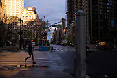 April 18, 2020<br /> New York, New York<br /> Mid-town Manhattan<br /> <br /> A runner heads west in midtown-Manhattan at 23rd street at 5th Avenue during the time of the cononavirus pandemic.