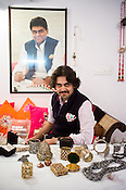 Siddharth Kasliwal of Gem Palace poses for a portrait in his office in Jaipur, Rajasthan, India. The portrait of his father, Munnu Kasliwal is seen in the background.