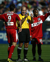 Referee Brian Hall explains his call to Ante Razov and Jeff Cunningham during MLS Cup 2003.  The San Jose Earthquakes defeated the Chicago Fire 4-2 in the MLS Championship at The Home Depot Center on November 23, 2003.