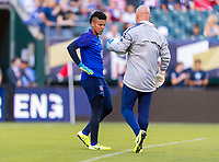 PHILADELPHIA, PA - AUGUST 29: Adrianna Franch #21 and Graeme Abel of the United States talk prior to warmups prior to a game between Portugal and the USWNT at Lincoln Financial Field on August 29, 2019 in Philadelphia, PA.