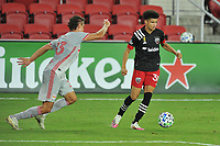 WASHINGTON, DC - SEPTEMBER 12: Kevin Paredes #30 of D.C. United battles for the ball with Aaron Long #33 of New York Red Bulls during a game between New York Red Bulls and D.C. United at Audi Field on September 12, 2020 in Washington, DC.
