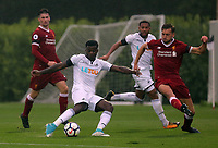 Pictured: Botti Biabi of Swansea (2nd L). Friday 11 August 2017<br /> Re: Premier League 2, Division 1, Swansea City U23 v Liverpool U23 at the Landore Training Ground, Swansea, UK