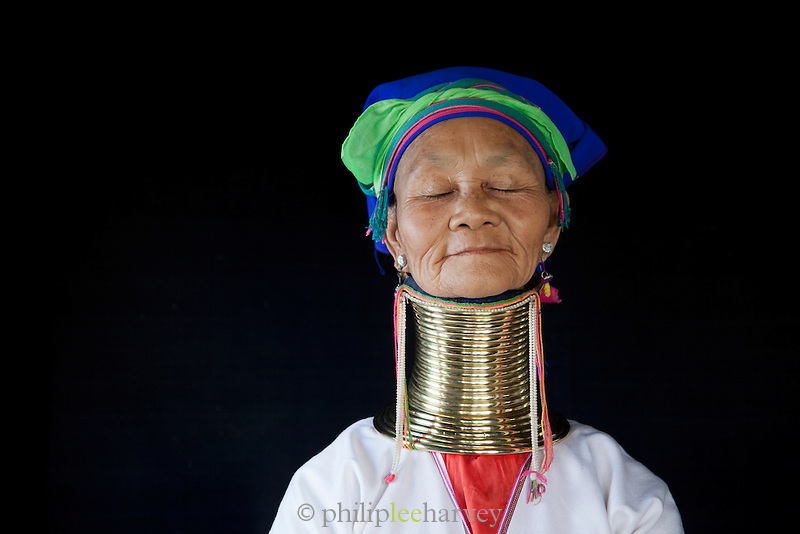 A woman of the Padaung tribe. Traditionally the women stretch their necks over time by adding brass rings, which then can no longer be taken off. Seen here in Ywa Ma village in Inle Lake, Shan state, Myanmar