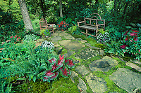 moss covered terrace and path in secluded shady flower garden with rustic twig cedar furniture  MIssouri USA released