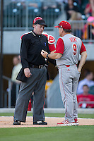 North Carolina State Wolfpack head coach Elliott Avent (9) argues a call with home plate umpire Brian Kennedy during the game against the Charlotte 49ers at BB&T Ballpark on March 31, 2015 in Charlotte, North Carolina.  The Wolfpack defeated the 49ers 10-6.  (Brian Westerholt/Four Seam Images)