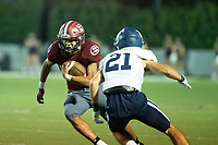 Gilberto Dominguez (22) of Springdale runs the ball against Malachi Cramer (21) of Springdale Har-ber at Jarrell Williams Bulldog Stadium, Springdale, Arkansas on Friday, October 9, 2020 / Special to NWA Democrat-Gazette/ David Beach
