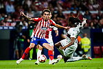 Ruben Semedo of SD Huesca (R) trips up with Carlos Munoz of Atletico de Madrid (L) during the La Liga  2018-19 match between Atletico de Madrid and SD Huesca at Wanda Metropolitano Stadium on September 25 2018 in Madrid, Spain. Photo by Diego Souto / Power Sport Images