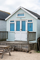 BNPS.co.uk (01202 558833)<br /> Pic: MaxWillcock/BNPS<br /> <br /> With video: https://youtu.be/YhZrWp9eNF4<br /> <br /> Pictured: The beach hut for sale.<br /> <br /> The prices of Britain's most expensive beach huts are on course to break through the £400,000 barrier due to the huge demand for them by rich staycationers. <br /> <br /> The wooden cabins at Mudeford in Christchurch, Dorset, have always commanded premium prices but they are now selling for more than people pay for a four bedroom house in many parts of the country.<br /> <br /> This week a hut went on the market for an asking price of £355,000, just two weeks after one sold within hours of being listed for £350,000.