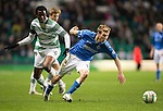 Celtic v St Johnstone.....04.03.15<br /> David Wotherspoon gets away from Efe Ambrose<br /> Picture by Graeme Hart.<br /> Copyright Perthshire Picture Agency<br /> Tel: 01738 623350  Mobile: 07990 594431