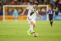 CARSON, CA - SEPTEMBER 21: Cristian Pavon #10 of the Los Angeles Galaxy traps a ball during a game between Montreal Impact and Los Angeles Galaxy at Dignity Health Sports Park on September 21, 2019 in Carson, California.