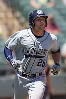 New Orleans Zephyrs outfielder Jake Marisnick #28 runs to first base during the Pacific Coast League baseball game against the Round Rock Express on May 5, 2014 at the Dell Diamond in Round Rock, Texas. The Zephyrs defeated the Express 13-4. (Andrew Woolley/Four Seam Images)