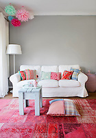 The majority of the brightly coloured cushions in the living room are made of recycled fabrics