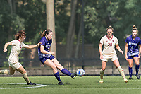 NEWTON, MA - SEPTEMBER 12: Cerys Balmer #24 of Holy Cross passes the ball as Jessica Carlton #32 of Boston College closes during a game between Holy Cross and Boston College at Newton Campus Soccer Field on September 12, 2021 in Newton, Massachusetts.