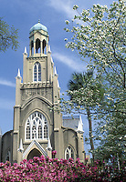 Episcopal Church in Savannah Georgia surrounded by blooming azaleas and dogwoods with stunning bell tower