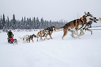 Linwood Fiedler's team runs up the river bank at the Nikolai checkpoint during the 2018 Iditarod race on Tuesday March 06, 2018. <br /> <br /> Photo by Jeff Schultz/SchultzPhoto.com  (C) 2018  ALL RIGHTS RESERVED