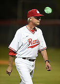 Lake Mary Rams coach Ed Nuss (16) walks off the field after a meeting at the mound during a game against the Lake Brantley Patriots on April 2, 2015 at Allen Tuttle Field in Lake Mary, Florida.  Lake Brantley defeated Lake Mary 10-5.  (Mike Janes Photography)