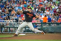 Andrew Suarez (30) of the Miami Hurricanes pitches during a game between the Miami Hurricanes and Florida Gators at TD Ameritrade Park on June 13, 2015 in Omaha, Nebraska. (Brace Hemmelgarn/Four Seam Images)
