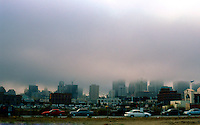 Ballparks: San Francisco Pacific Bell Park--view of city from parking lot, 6:30 PM on a July day and the fog is rolling in.
