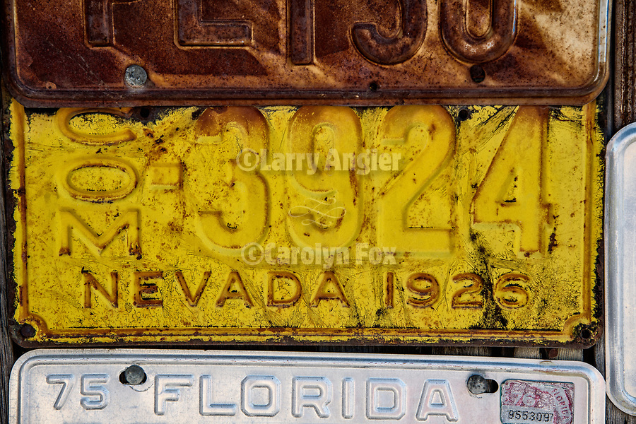 Rusty auto & truck license plate collection on a wooden wall, Imlay, Nev.