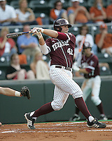 Texas A&M DH Darby Brown swings against Texas on May 16th, 2008 in Austin Texas. Photo by Andrew Woolley / Four Seam images.