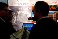 """Visitors look at an exhibition on alternative energy. Renewable sources will be helping to meet the world's demand for energy in the future. This development opens new markets and opportunities for business. Hoping to make """"green business"""" and """"green profit"""" over 60 exhibitors took part in the The North European Renewable Energy Convention (Nerec) , in Norway, presenting their solutions for renewable energy in the future. .© Fredrik Naumann/Felix Features"""