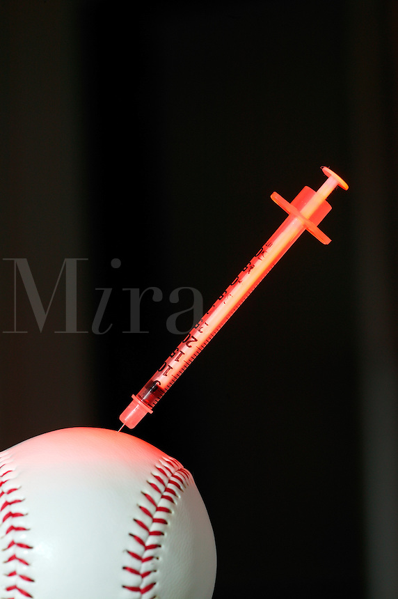 Baseball with hypodermic needle.