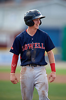 Lowell Spinners shortstop Grant Williams (11) looks to his teams bullpen after reaching first base on a walk during a game against the Batavia Muckdogs on July 15, 2018 at Dwyer Stadium in Batavia, New York.  Lowell defeated Batavia 6-2.  (Mike Janes/Four Seam Images)