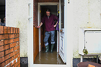 Flooding effected the villages of Aberdulais and Tonna in the Neath Valley after Storm Callum brought heavy rain and wind to the area cuasing the River Neath to reach bursting point.<br /> Luke Springthorpe is pictured at his flooded home, Canal Side, Tonna, Neath. Saturday 13 October 2018