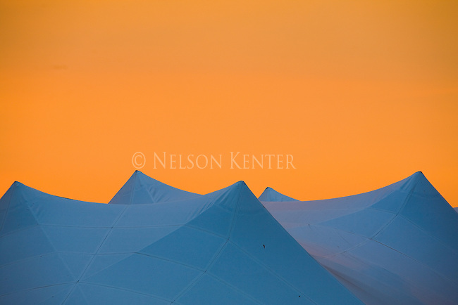 The tent tops in Caras Park at sunset in downtown Missoula, Montana