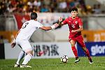 Tan Chun Lok of Hong Kong (R) in action during the International Friendly match between Hong Kong and Jordan at Mongkok Stadium on June 7, 2017 in Hong Kong, China. Photo by Marcio Rodrigo Machado / Power Sport Images
