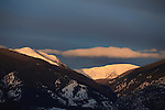 The last rays of sunlight on the snowy peaks above Gold Creek in western Montana