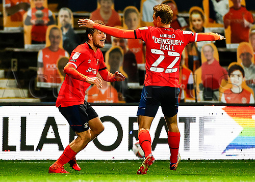 21st November 2020; Kenilworth Road, Luton, Bedfordshire, England; English Football League Championship Football, Luton Town versus Blackburn Rovers; Luke Berry of Luton Town scores to take Luton Town into 1-0 lead in the 69th minute and celebrates with Kiernan Dewsbury-Hall of Luton Town