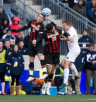 Connor Klekota (3) of Notre Dame goes up for a header with Jake Pace (20) and Alex Skinsky (9) of Maryland  during the NCAA Men's College Cup final at PPL Park in Chester, PA.  Notre Dame defeated Maryland, 2-1.