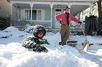 Children enjoy playing on the snow in Charlottesville, VA.