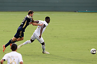 CARY, NC - AUGUST 01: Boluwatife Akinyode #3 earns a red card for this foul on Steven Miller #31 during a game between Birmingham Legion FC and North Carolina FC at Sahlen's Stadium at WakeMed Soccer Park on August 01, 2020 in Cary, North Carolina.