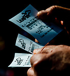 LAUREL, MARYLAND - OCTOBER 22: A gambler looks over his wagers on Maryland Million Day at Laurel Park on October 22, 2016 in Laurel, Maryland. (Photo by Scott Serio/Eclipse Sportswire/Getty Images)