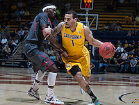 Justin Cobbs of California dribbles the ball during 2014 National Invitation Tournament against Arkansas at Haas Pavilion in Berkeley, California on March 24th, 2014.  California defeated Arkansas, 75-64.