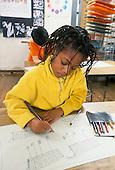 MR/Schenectady, New York.Yates Arts Magnet School - Grade 1.Girl (6, African-American) draws shopping cart during art class..MR: Bre4.PN#:30976      FC#:20919-00318.scan from slide.© Ellen B. Senisi