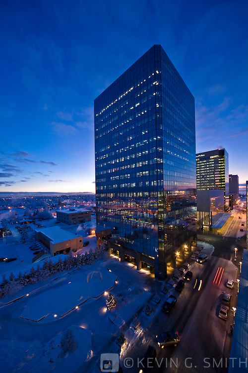 Rooftop view of the Anchorage skyline, with the Atwood Tower in the foreground, twilight, winter, Southcentral Alaska, USA.