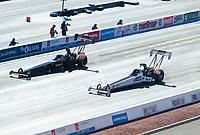 Nov 1, 2020; Las Vegas, Nevada, USA; NHRA top fuel driver Jim Maroney (near) alongside Troy Buff during the NHRA Finals at The Strip at Las Vegas Motor Speedway. Mandatory Credit: Mark J. Rebilas-USA TODAY Sports