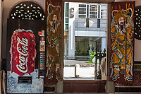 Singapore, Thian Hock Keng Taoist Temple Door Guardians: Soft Drink Vending Machine and Traditional  Guardian Deity.