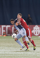 09 March 2013: Toronto FC defender Darren O'Dea #48 and Sporting KC forward Claudio Bieler #16 in action during an MLS game between Sporting Kansas City and Toronto FC at The Rogers Centre in Toronto, Ontario Canada..Toronto FC won 2-1.