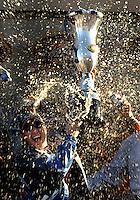 Nascar Busch Series driver Martin Truex Jr. celebrates after winning the 2004 championship. Mandatory Credit: Mark J. Rebilas